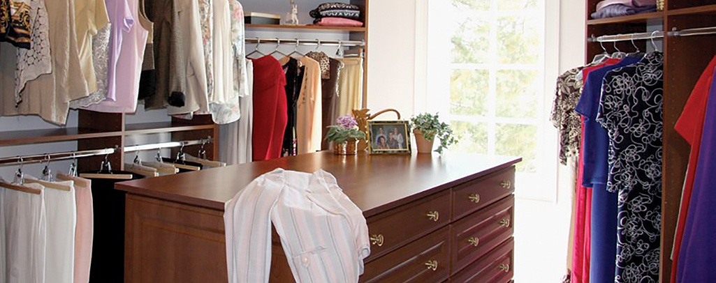 Walk in bedroom closet with island
