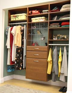Bedroom closet with two sets of hanging heights.