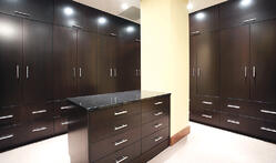 Dressing room with rich wood cabinetry