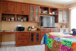 Bedroom with an office. Adding cabinets and a desk in a guest room will turn the space into one with a dual purpose.