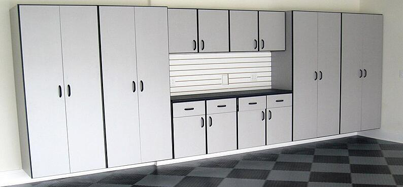 New garage cabinets and flooring for a grage with a a dual purpose.