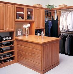 Pearwood closet which is his and hers, has an island, and has a place for shoes.