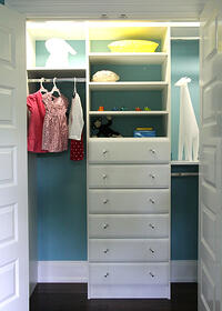 child's closet with hanging rods, drawers and shelves