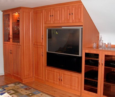 Once your basement walls and floor are complete a good place to start is an entertaiment center with storage.