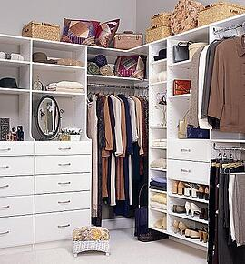 Organized closet interior. Using double rods add double the storage space.
