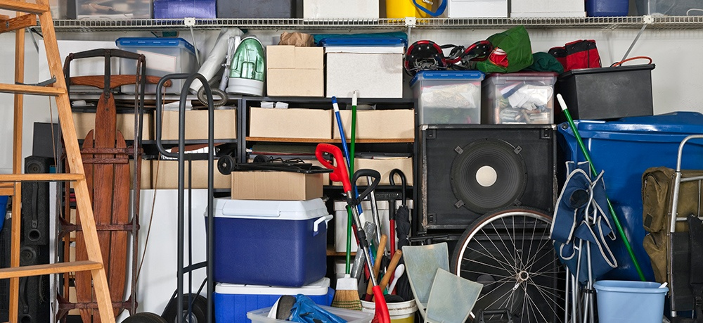 A cluttered, unorganized garage can be an overwhelming job to clean up.