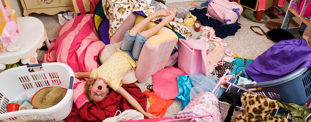Kid in messy bedroom