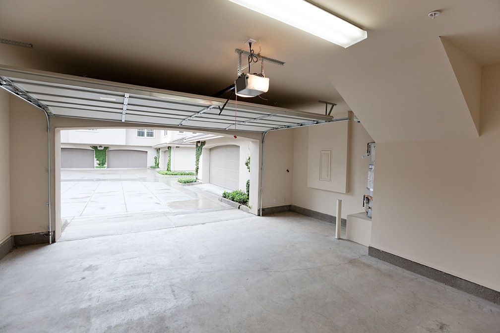 Empty garage with door open and light on. A well lit garage is a safer place.