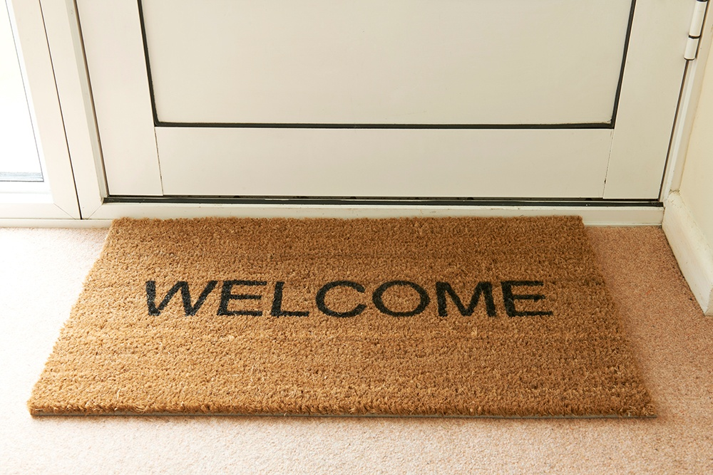 Welcome door mat. Keeping one by all outside entrances will keep your home cleaner.