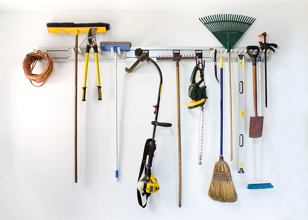 Hanging tools on walls is a great way to get your garage organized.