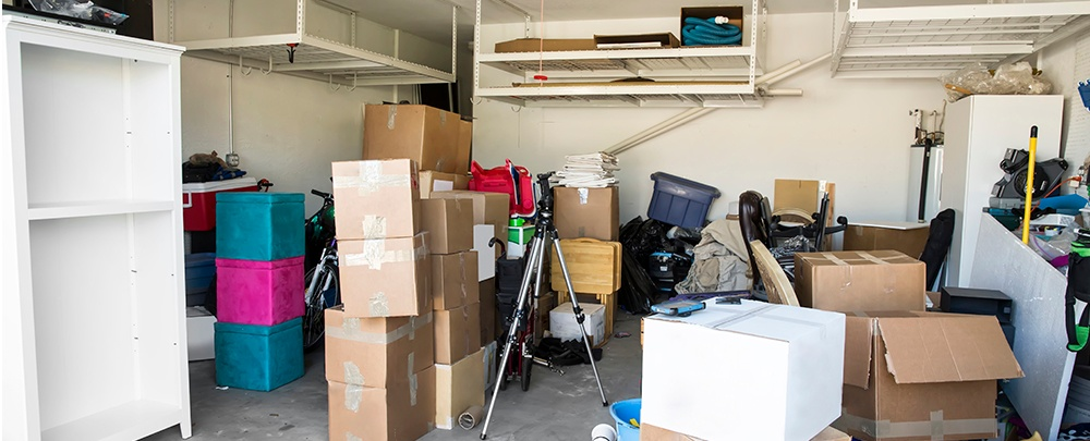 Messy garage. A messy garage can be turned into all sorts of great useful living spaces.