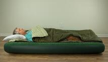 Man sleeping on air mattress on floor